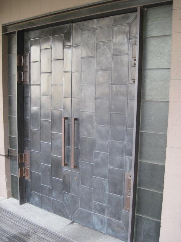Double gallery doors clad with interlocking raised-seam zinc panels & Doors - THE TINMAN